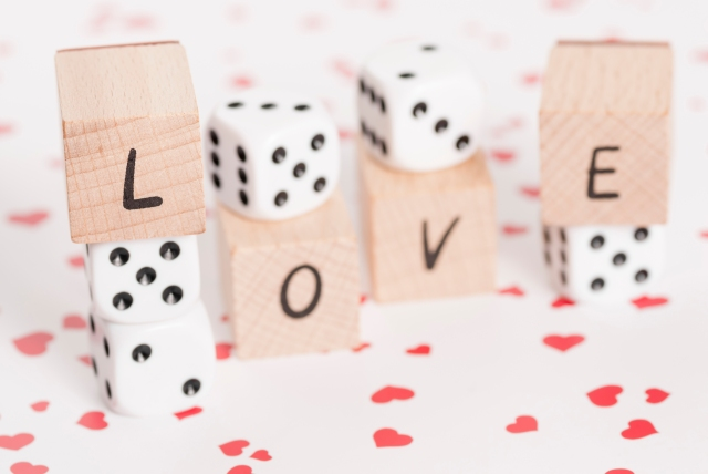 Love and Dice on Heart Background.
